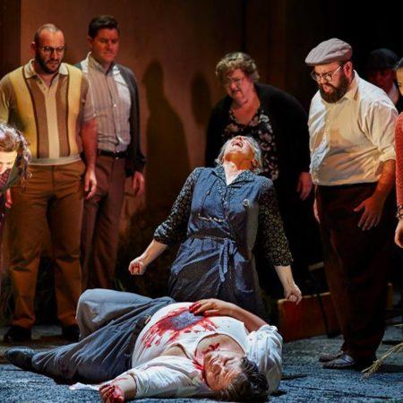 Dragana Radakovic as Santuzza, Diego Torre as Turiddu, Dominica Matthews as Mamma Lucia and the Opera Australia Chorus in Opera Australia's production of Cavalleria Rusticana / Pagliacci.