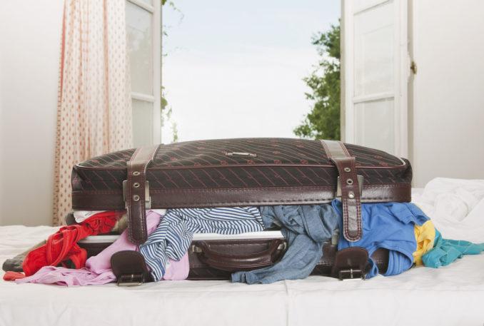 stuffed suitcase, hotel room, Tuscany, Italy