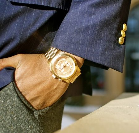 Man wearing gold watch