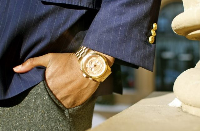 Man wearing gold watch