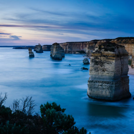 The 12 Apostles rock formation in Port Campbell National Park, a major Australian natural landmark on the Great Ocean Road. A long exposure of the 12 Apostles taken at night.