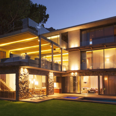 Modern house illuminated at night