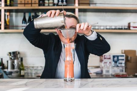 Making cocktails bartender mixologist