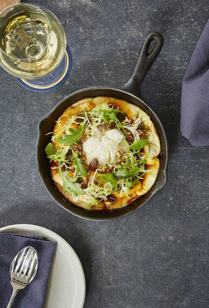 Husk & Vine Kitchen and Bar burrata cheese, garlic bread, chermoula, raisin & pinenut