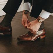 Oscar Hunt Brogue Brown tying shoe laces