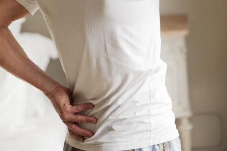man sore back neck lower back