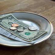 Tipping dollars on plate
