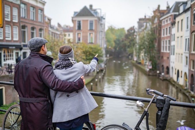 Eurail train Couple enjoying a view of a canal in Utrecht, The Netherlands