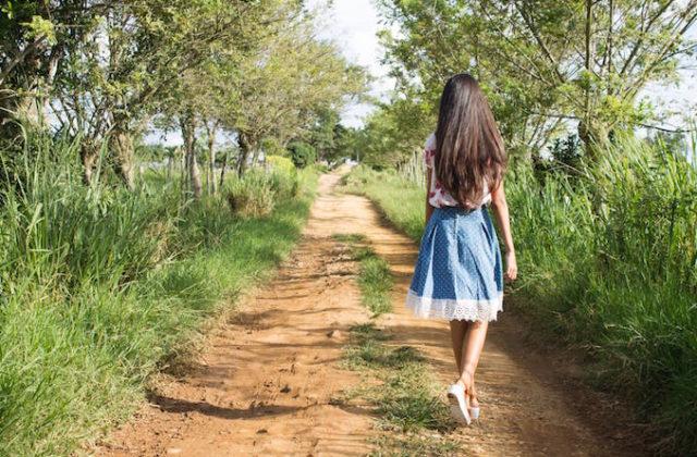 Girl walk track bush