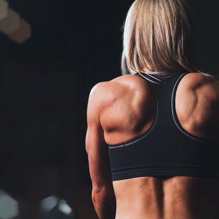Woman fitness back muscles