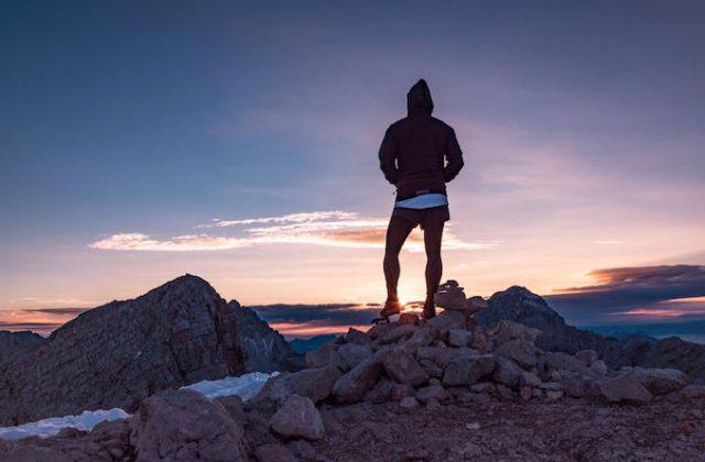Man hiking mountain activewear