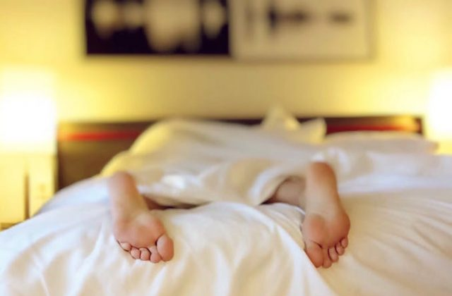 Person feet bed