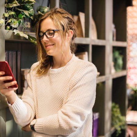 Woman phone smiling online