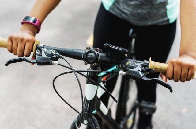 Hands on bike handlebars