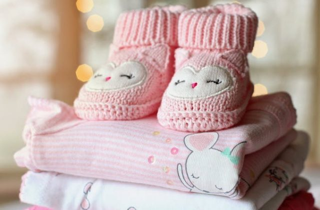 Baby shoes on a baby blanket