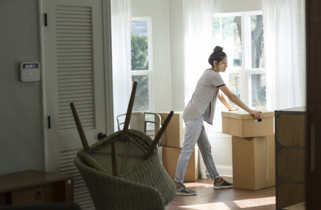 Woman moving in boxes