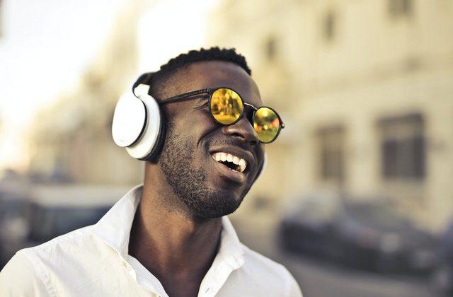 Black man sunglasses headphones