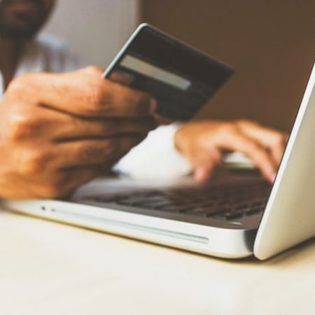 Man hands credit card online shopping