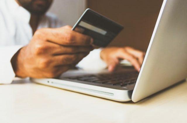Man hands credit card online shopping