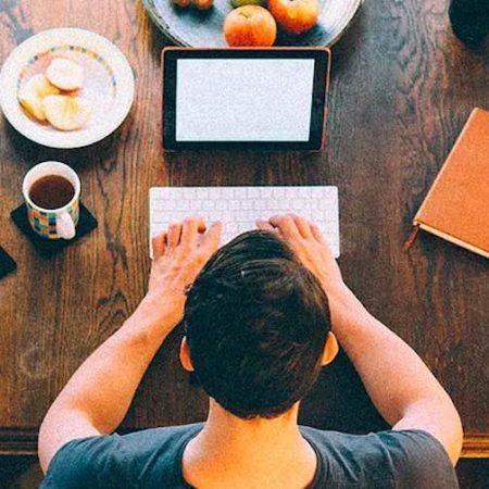 Man writing laptop book